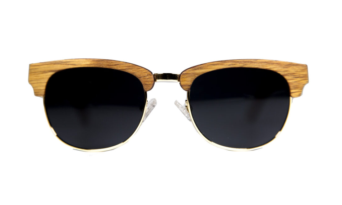 Head on view of the Keys sunglasses. The frames are built with wood on the brow line and metal around the lenses.